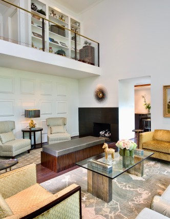 two story living room with eclectic furniture and leather bench and glass table