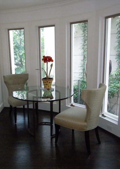 breakfast nook in front of contemporary bay window