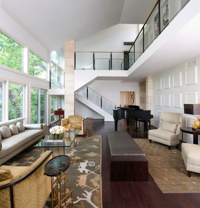 Eclectic two story living room with large windows and grand piano